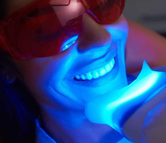 Patient receiving in office teeth whitening